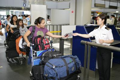 北京に出入国セルフサービスホール2ヶ所新設  わずか3分でパスポート発行